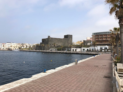 View of the port of Pantelleria with castello Barbacane in the background.