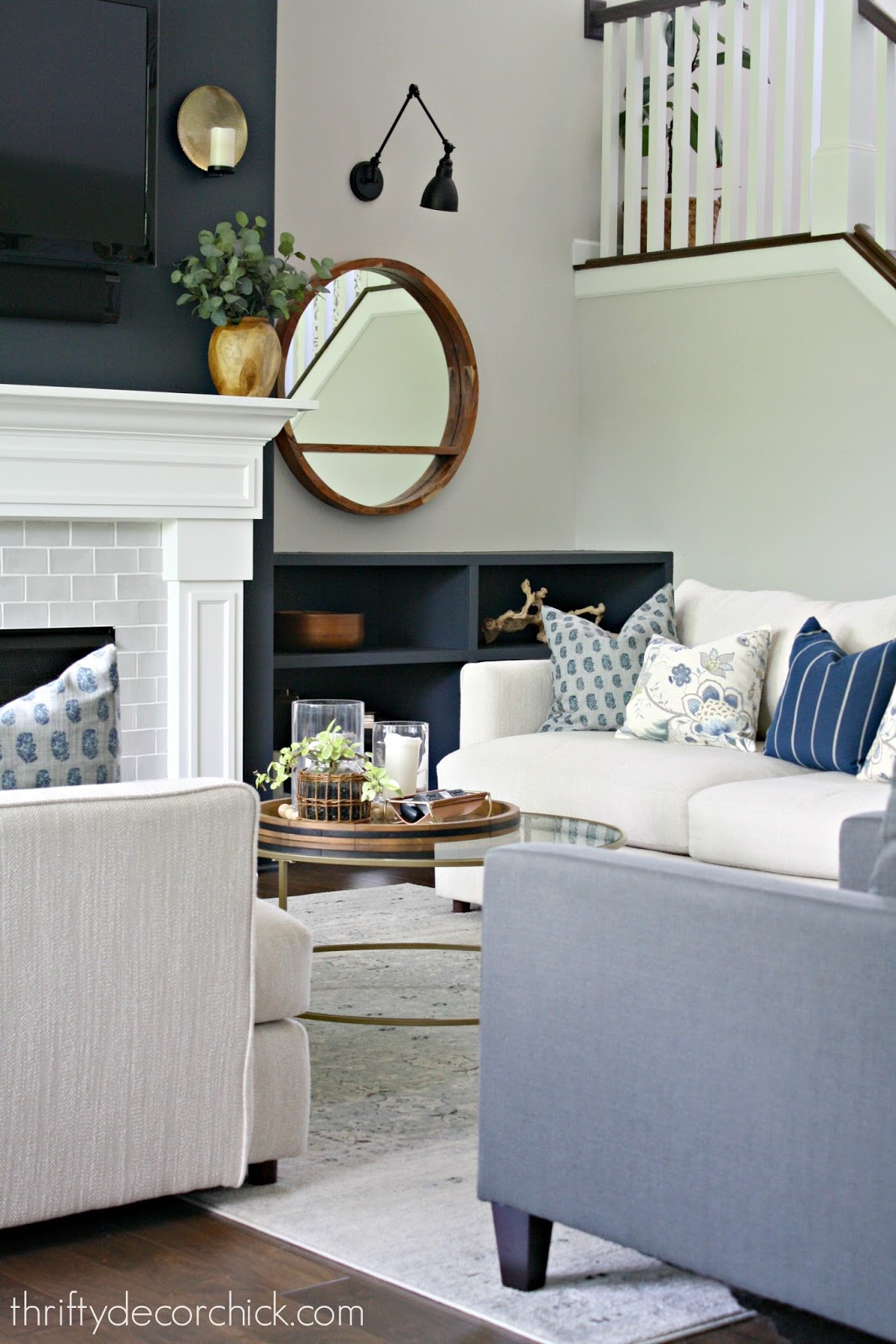 Blue green and gray pillows on light sofa