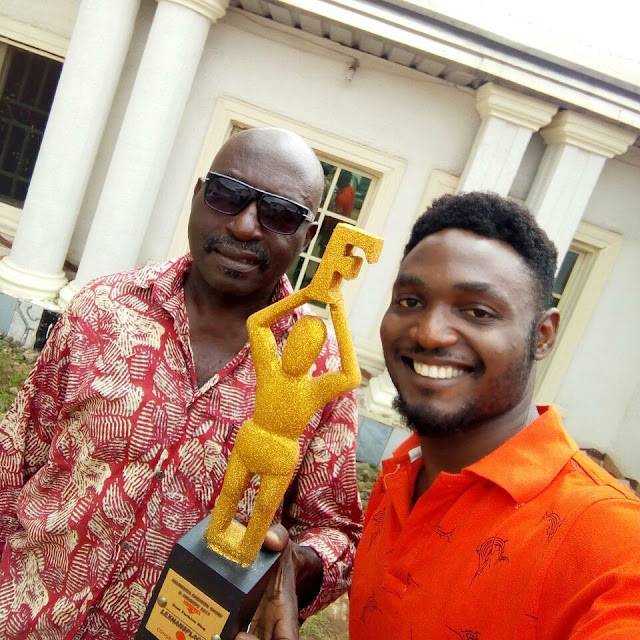lexhansplace and dad all smiles with his award from anambra fashion show awrds