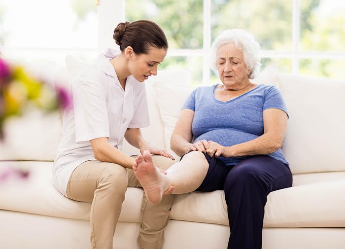 Nurse examining patient's leg