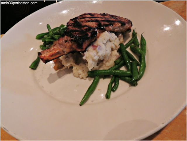 Grilled Pork Chop: Center-Cut Chop Served with Housemade Apple Sauce, Mashed Potatoes and Fresh Spinach