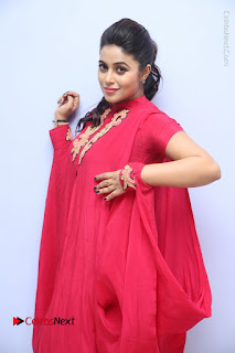 Actress Poorna Latest Stills in Red Dress at Rakshasi First Look Launch  0146.JPG