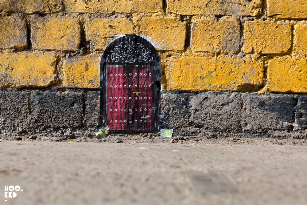 Miniature Street Art door by Mexican artist Pablo Delgado