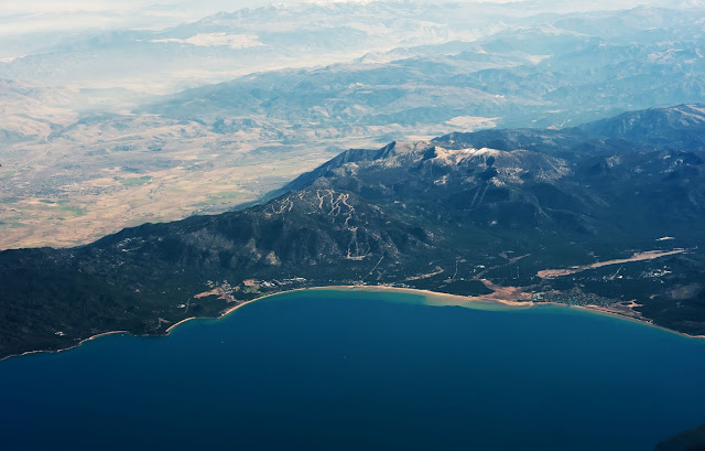 An aerial photo of a Lake and mountain range in the US.