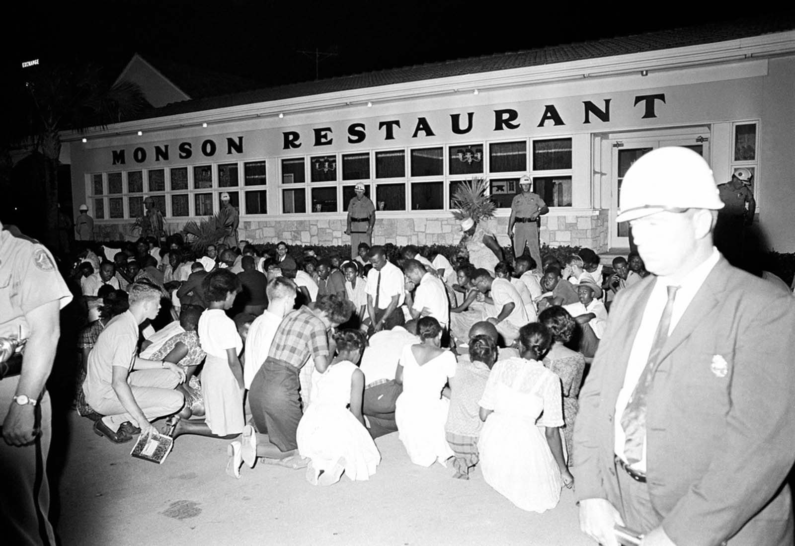 Integration demonstrators, after a long march through the white business and residential section of St. Augustine, Florida, held prayer sessions at the Monson Motor Lodge Restaurant on June 18, 1964, The restaurant has been the target of many sit-in attempts by the Southern Christian Leadership Conference.