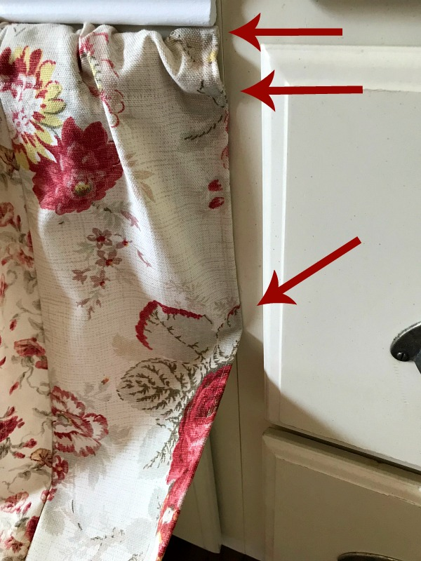 Apply Hot Glue To Secure Sink Skirt along the side of the cabinet