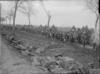 Battle of the Scarpe. Working party of British troops going up to the forward area along the Arras-Cambrai road, April 1917. © IWM (Q 2030) IWM Non-Commerical Licence
