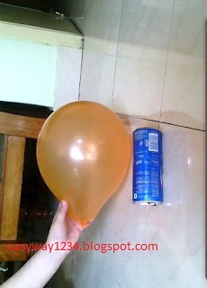 A balloon and a rolling can