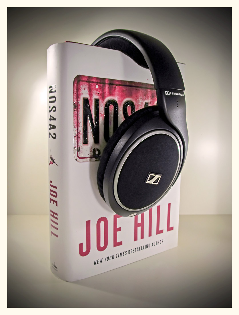 Sennheiser HD-558 (with 'NOS4A' by Joe Hill abused as a headphone stand)