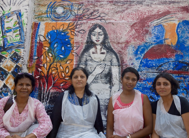 The job is done...Artists in front of the wall panel they painted at The Art Walk 360, (L to R) Milburn Cherian, Chitra Vaidya, Sumana Nath De, Ami Patel