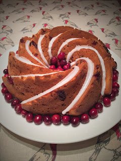 Cranberry Yoghurt Bundt Cake decorated with cranberries