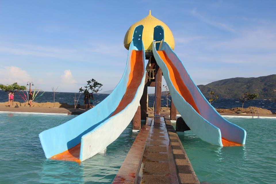 The slide at Sea Spring Resort Hotel's swimming pool