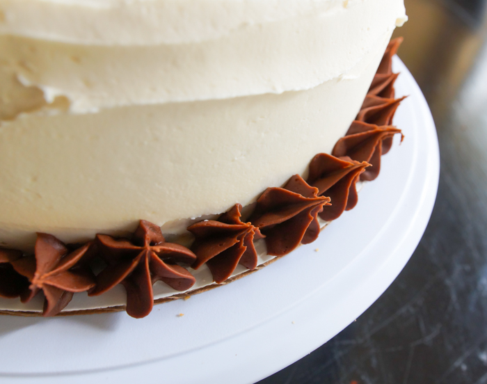 Yellow Cake with Chocolate Filling and Salted Caramel Buttercream | bakeat350.net