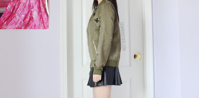 Army green edgy lace-up criss-cross tied longline bomber jacket from SheIn, worn with a black leatherette faux leather suspender skater dress.
