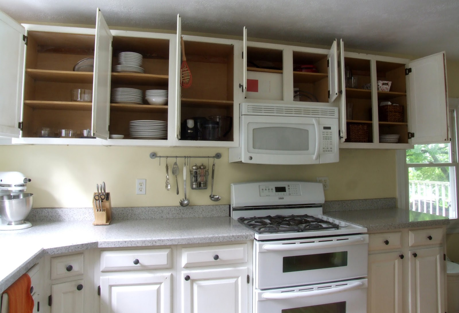I D Love To Jump On The Cur Kitchen Trend And Replace Upper Cabinets With Open Shelving But M Not Sure How Good That Would Be For Value Of