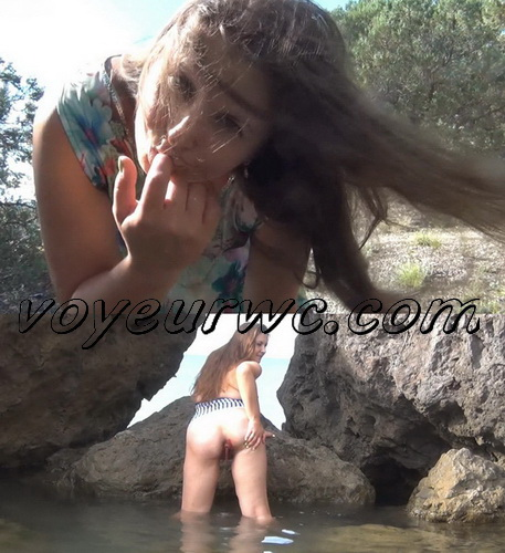 Sexy woman pooping in bathing suit. Woman pooping and pissing on a tree (Cutie Nadia Pooping 13)