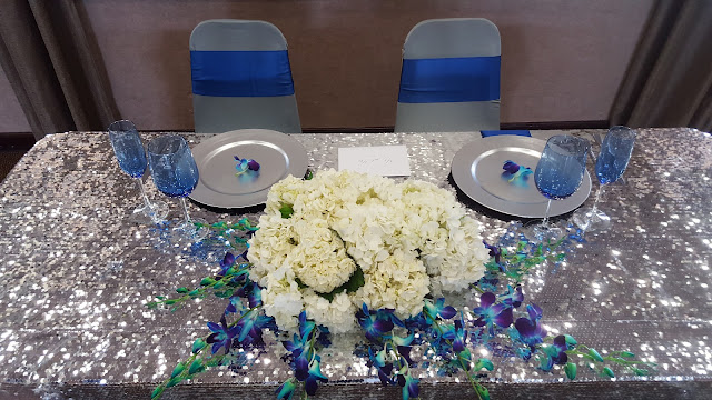 royal blue and silver wedding by eventsojudith, silver sequin, blue orchids, white hydrangeas