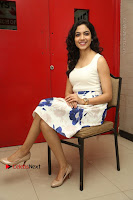 Actress Ritu Varma Stills in White Floral Short Dress at Kesava Movie Success Meet .COM 0228.JPG