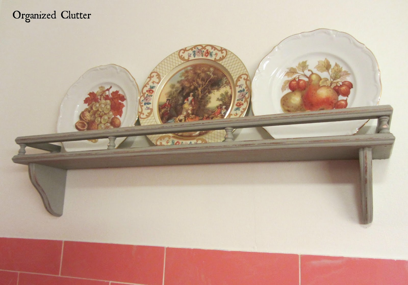 Plates in a Vintage Bathroom www.organizedclutterqueen.blogspot.com