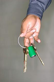Hand holding prison keys