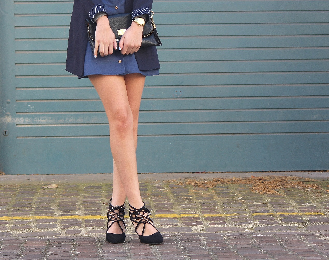 peexo fashion blogger wearing a line button down skirt and lace up heels