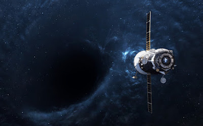 Pic of space craft heading towards a black hole