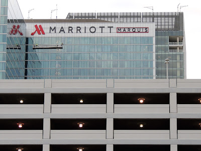 West side of MARRIOTT MARQUIS and parking garage in front