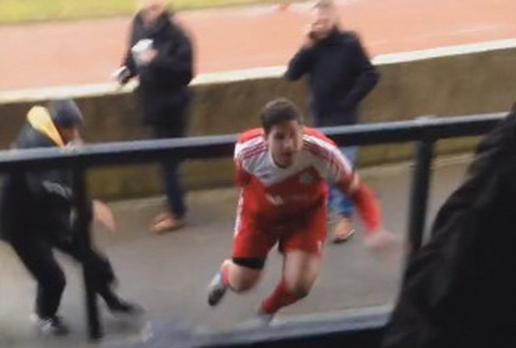 Goole player Karl Colley is seen trying to attack a fan after being sent off against Coalville