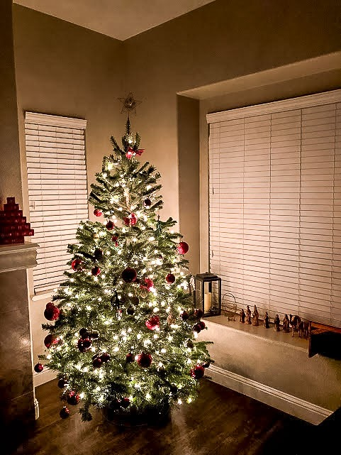 Glowing Christmas Tree with Gold Twinkle Lights and Red Ornaments