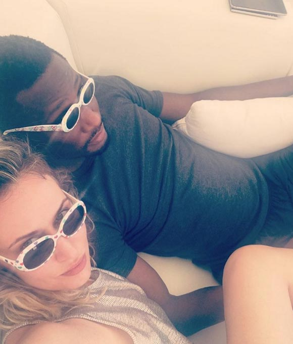 Mikel Obi kisses his oyibo baby mama as couple holiday in Spain