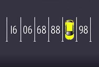 El número de l'aparcameny és el 87, ja que la imatge es veu invertida