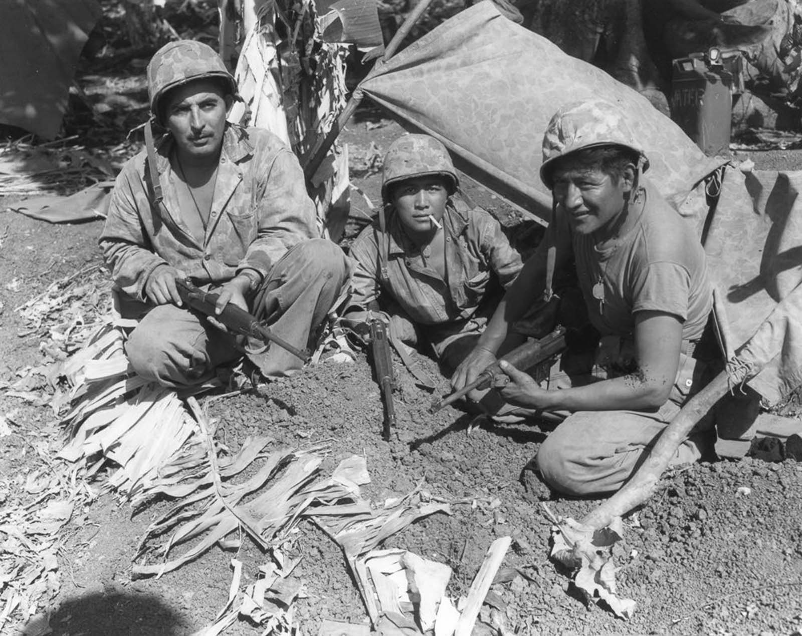 Corporal Oscar Ithma, Private First Class Jack Nez, and Private First Class Carl Gorman on Saipan.