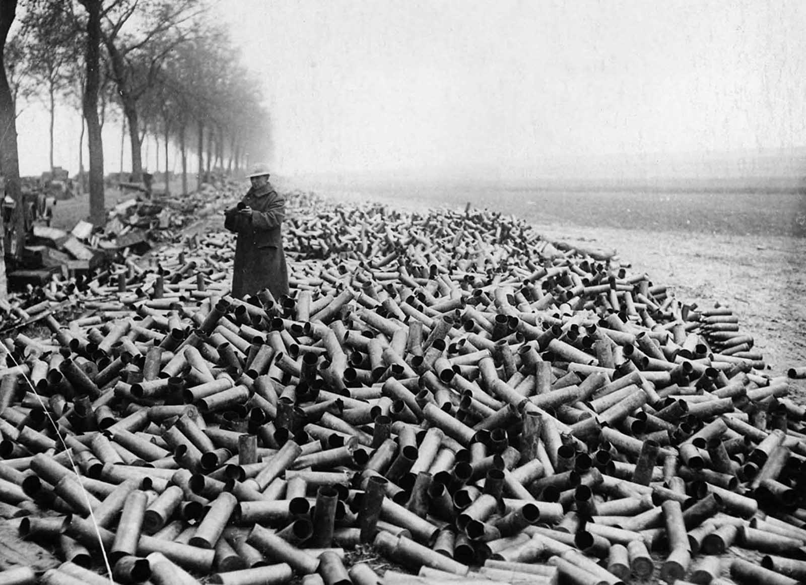 Mountains of shell cases on the roadside near the front lines, the contents of which had been fired into the German lines.