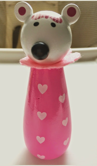 pink and white wooden mouse animal toy skittle