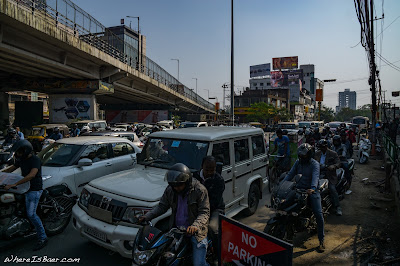 just a random intersection in India , chaotic motor cycles road india, WhereIsBaer.com Chris Baer