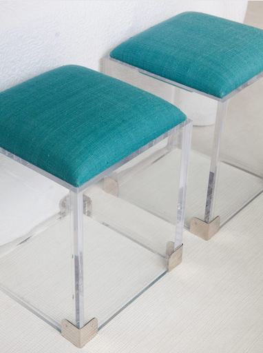Close up of turquoise and Lucite accent ottoman