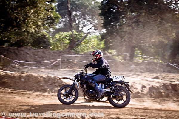 I hope that you have already checked other Photo Journeys from OYA Motorsports, Mohali. If not, just check out following two Photo Journeys and continue with this oneJk Tyre OYA Auto Cross and Motorcross @ Mohali, Punjab || Motorsports in India Dust Storm at Mohali (Chandigarh), Punjab || JKTYRE OYA Auto Cross and Motorcro Let's check out this Photo Journey from Mohali...In this Photo Journey, we are sharing some of the photographs from space outside the ground where all these activities happened during JK Tyre OYA Autocross and Motorcross. There were lots of modified cars and jeeps on the ground. Some of them were amazingly done with wonderful collection of lights, specially designed tyres and other stuff, which I don't understand. Aneesh's Car @ Oya Autocross & Motorcross. Somehow I missed F1 stickers on the car and apart from that this car flies like anything. After the event, we used the same to roam around Chandigarh. Here is a an Indian couple from US, who are out of world trip for last few months and they are using bike for the trip. It seems that both of them are very interested in Motorsports, as they have also participated in Raid-de-Himalayas in Oct'2011. I would love to know more about their plans about this trip !! One of the Mahindra 4 by 4 doing some practice on outer track of the ground. In fact, whole ground was designed in an amazing way. This ground is usually used for Sabzi-mandi in Phase-7 of Mohali, Punjab. For this event, various tracks were designed with appropriate distance, curves and hurdles on the way. There were some under ground paths carved as well. One of the popular Indian Rider and winner of many national bike riding events !!! He did some demo rides during the breaks and he was only one who was literally flying on his bike. There was an elevated hurdles on the ground an most of the competitors were very cautious about the same.While he was taking advantage of that elevation to fly in the air. Some of the photographs of his bike flying in the air are available on links shared above.Bike competitions were most exciting and other reason was visibility.  People around this ground could not see car racing clearly, as there was lot of dust around the ground. While bike racing was very clear and there were more than 5 participants at a time as compared to 2 car competitors at any point of time.I am not sure about standard speed but somehow they seemed slow as compared to riders who freely ride on hilly/plain roads. Probably these curvy tracks were designed in such a way that it was not easy to maintain the speed very high.It was 3rd time, when OYA was organizing this event in Mohali, Punjab. JK Tyre was one of the main sponsor of this event, although I saw many of the other posters on the ground, which are also shown through some of the photographs shared in other two Photo JourneysThe day was wonderfully spent on OYA Motorsport ground with all these passionate riders !!! First day of my official shutdown spent well in Mohali !!!