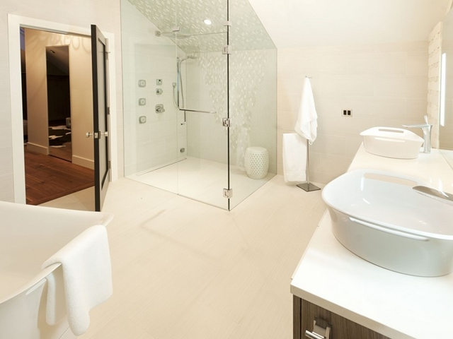 Picture of white bathroom with shower