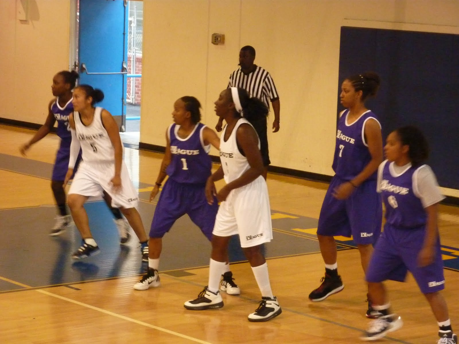 b61ab33990f Team Purple (dark uniforms) and Team Hustle all brace for the pass inside.