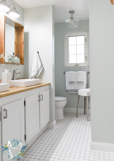 Light gray bathroom with wood accents
