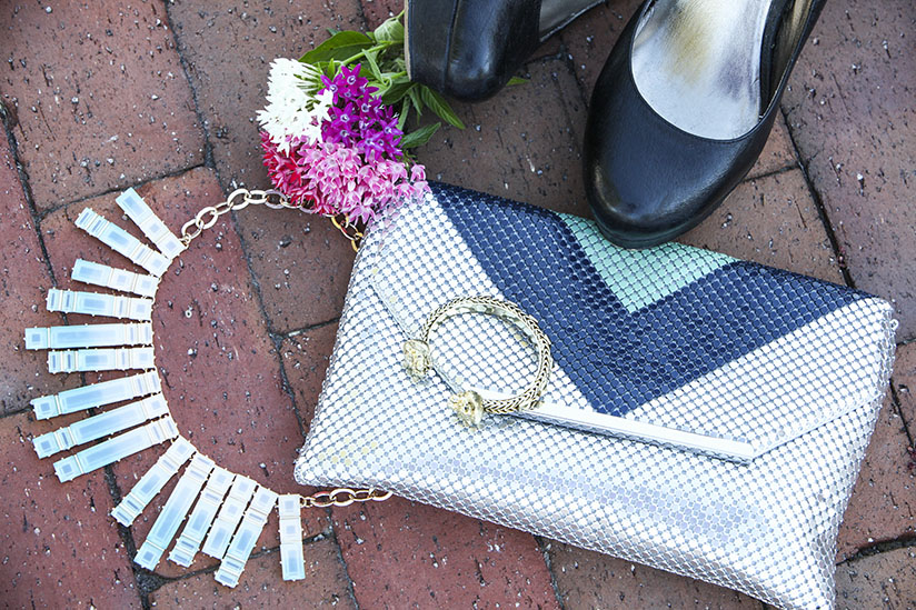 The skinny dip necklace from bauble bar and a metallic clutch by Jessica McClintock