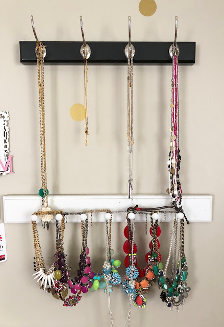 Organized Necklaces hanging on coat hooks