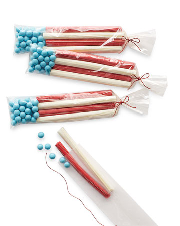 These treat bags filled with small blue candies and red/white licorice resemble American flags.