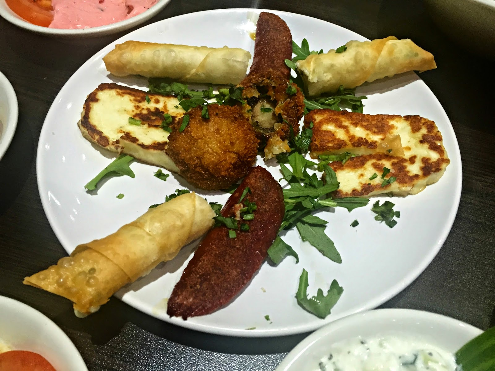Plate of starters with halloumi cheese
