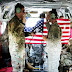 NY Army National Guard Specialist Kevin Hamilton reenlists on board CH-47 helicopter