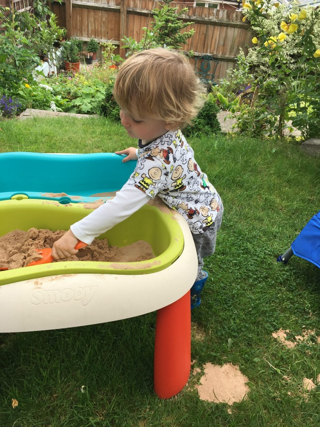 toddler-playing-with-sand
