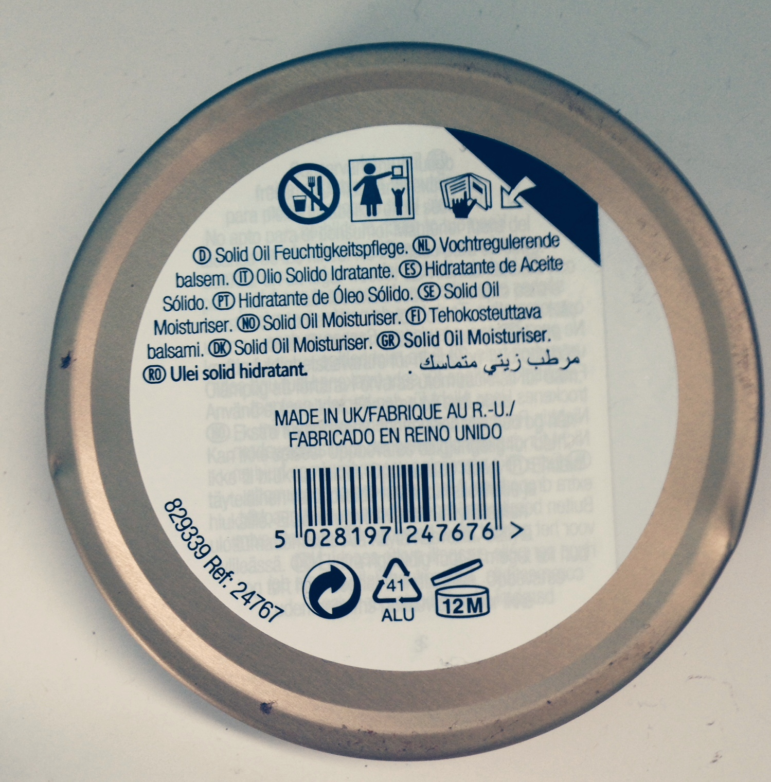 The underside of a tin of Wild Argan Oil by the Body Shop