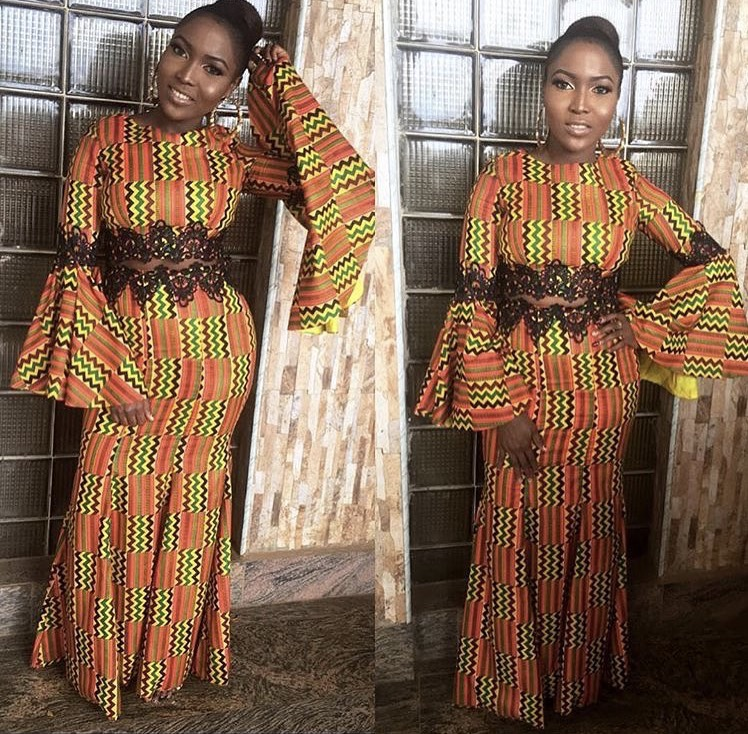 girl wearing a kente bell sleeve dress