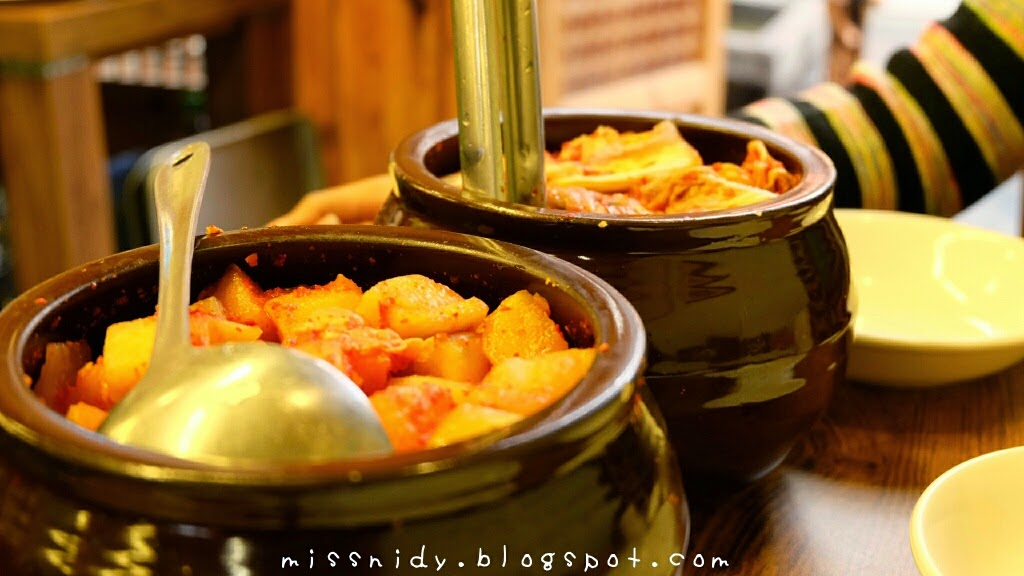 tasting kimchi at tosokchon seoul