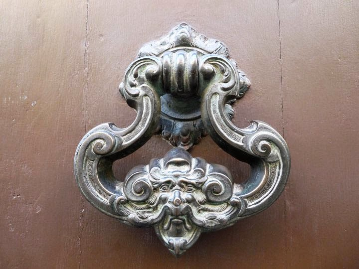 A spirit's face door knocker as seen in Italy